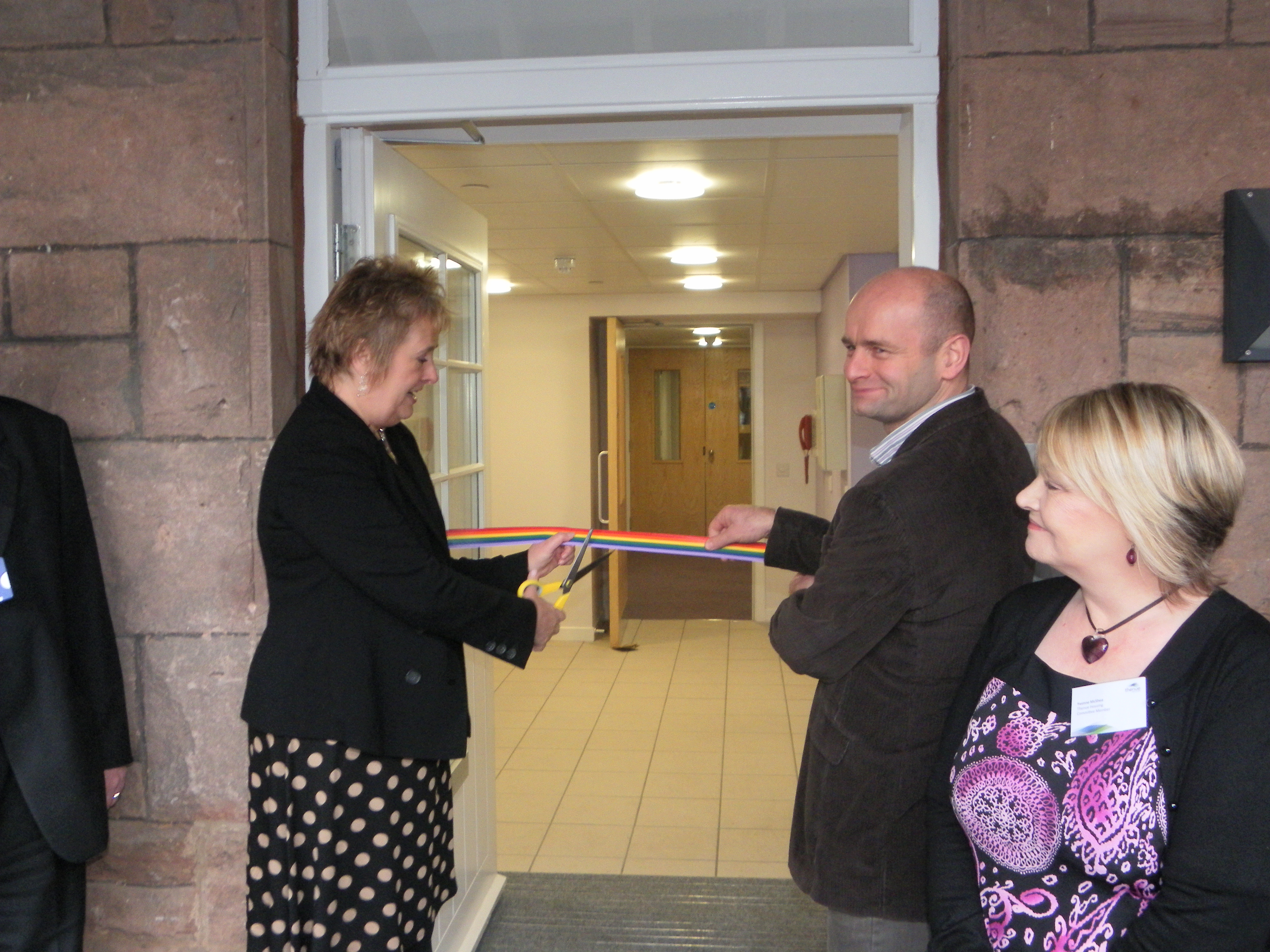 - Minister cuts ribbon to official open Rainbow House, looked on by Vic Walker, CrossReach Managing Co-ordinator and Yvonne McShea, Thenue Housing Chairperson